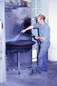 Ken Willan spraying table top