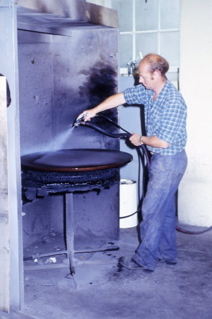Ken Willan spraying table top